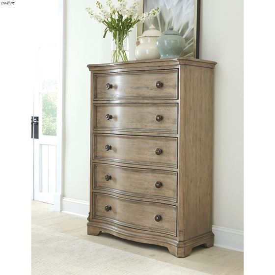 The Corinne 5 Drawer Chest in Acacia in room